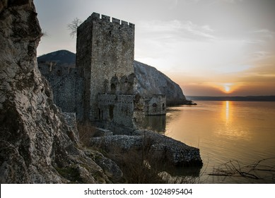 Stronghold on the Danube/travel picture of a fourteen century stronghold ruin on the river Danube in Serbia at sunset.