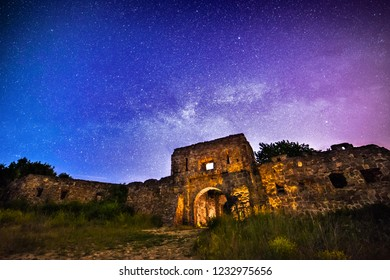 Stronghold ruins under starry sky