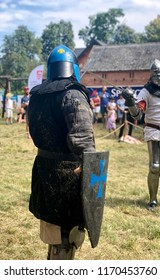 STRONSKO, POLAND - August 4, 2018: Knight in full armor is preparing for a battle during a reenactment of a battle of medieval knights during a historical festival in Stronsko, Poland.