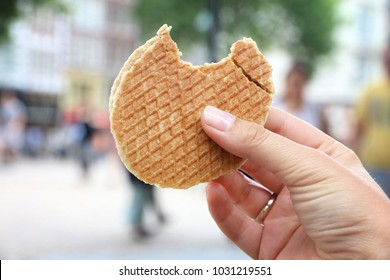 Stroopwafel in Amsterdam - typical Dutch food - two circular pieces of waffle filled with caramel-like syrup.
