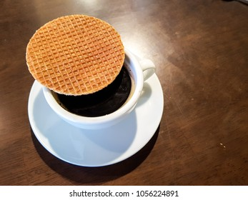 Stroopwafel a famous waffle from dutch. Eat it with black coffee.