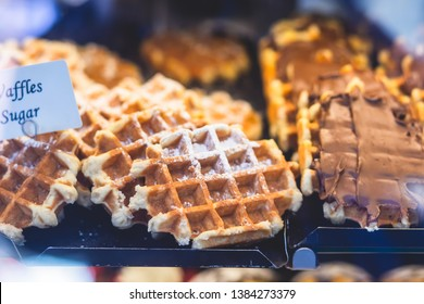 Stroopwafel, stroop wafel, also known as syrup waffle, is one of the famous Dutch snack from The Netherlands, counter with different candy desserts, sweet tasty candy dessert variety in Amsterdam