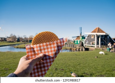 Stroopwafel in Zaanse Schans - typical Dutch food - two circular pieces of waffle filled with caramel-like syrup.
