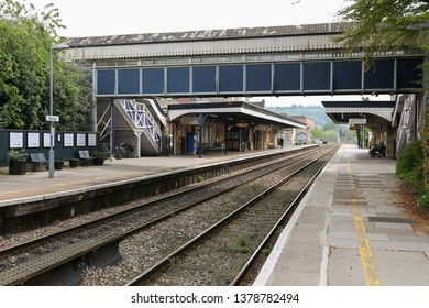 STROUD, ENGLAND - April 23, 2019: Great Western Railway station in the city of Stroud, cotswolds area.Empty platforms and a footbridge crossing to tracks.