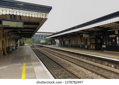 STROUD, ENGLAND - April 23, 2019: Great Western Railway station in the city of Stroud, cotswolds area.Empty platforms and a footbridge crossing to tracks. Mind the Step.