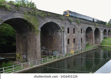 Stroud, Gloucestershire / England - May 28th 2019: The derelict Capel's Mill and Brunel's railway viaduct in Stroud, UK.