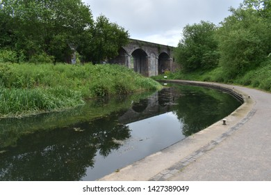 Stroud, Gloucestershire / England - May 28th 2019: Railway viaduct over the Thames and Severn Canal, in Stroud.