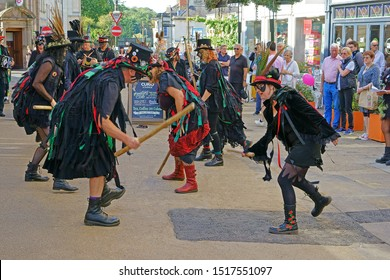 Stroud, Gloucestershire, UK, September 21st, 2019, Styx of Stroud Border Morris dancing to the music in their traditional costumes and hitting each others battons.