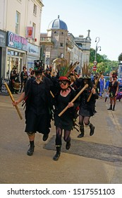Stroud, Gloucestershire, UK, September 21st, 2019, Styx of Stroud Border Morris dancing to the music while parading in their traditional costumes.