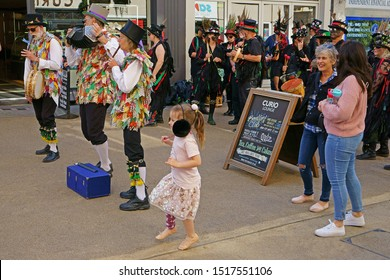 Stroud, Gloucestershire, UK, September 21st, 2019, young girl dancing to the music of the Morris men.