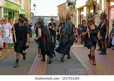 Stroud, Gloucestershire, UK, September 21st, 2019, Styx of Stroud Border Morris dancing to the music in their traditional costumes to the amusement of the onlooking members of the public.