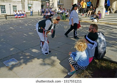 Stroud, Gloucestershire, UK, September 21st, 2019, Morris Dancer talks to a young girl about her dancing outside the Stroud Subscriptions rooms.