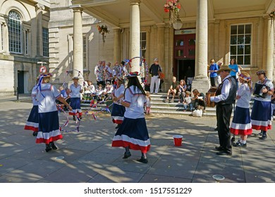 Stroud, Gloucestershire, UK, September 21st, 2019, Gloucestershire Female Morris dancers with hoops and traditional costumes performing outside the Subscription rooms.