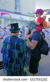 Stroud, Gloucestershire, UK, September 21st, 2019, young boy raised high on his fathers shoulders to get a better view of the Morris Dancers.
