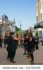 Stroud, Gloucestershire, UK, September 21st, 2019, Styx of Stroud Border Morris dancing to the music in their traditional costumes with battons held high.