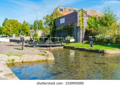 STROUD, UK - SEPTEMBER 23, 2019: A lock on the Stroudwater Navigation canal in Stroud, Gloucestershire. The canal was opened in 1779 and linked Stroud to the River Severn.