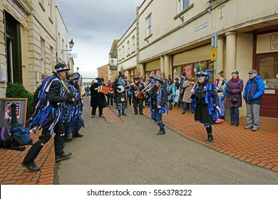 Stroud Wassail, A Winter Community Merry making Festival, The Cotswolds, Gloucestershire, 14th January 2017, Bakanalia Border Morris dancing to the tune of their musicians, John Street, Stroud