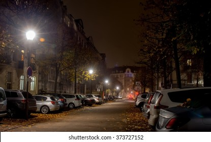 Strsburg Night city, roadway , cars are parked along the road lighting street lights