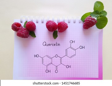 Structural chemical formula of quercetin molecule with fresh sweet raspberries. Berries as a rich source of various polyphenols, including the flavonoid quercetin. It has a variety of health benefits.