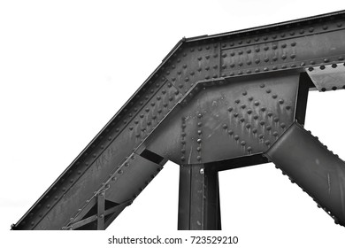 Structural elements of a steel bridge over a river in Thailand. This route was constructed by the captive in world war II. This image was blurred or selective focus. Black and white picture.