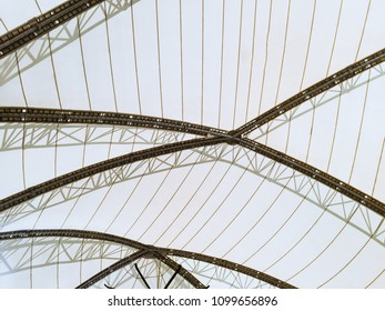 Structural glass facade curving roof of fantastic building. Abstract background