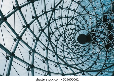 Structural glass facade curving roof of fantastic office building. Modern and Contemporary architectural fiction with glass steel column.Abstract architecture fragment.
