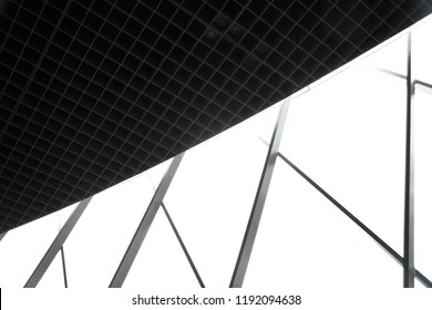 Structural glass wall and drop ceiling with grid structure. Collage photo of office building interior fragments. Abstract black and white modern architecture background in grunge technique.