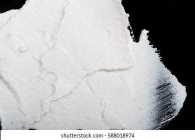 a2bb2a524 Structural plaster white on a black background. White Cream. paint smear.  Plasticine