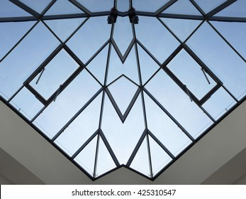 Structural transparent roof / ceiling of a modern building. Abstract glass architecture photo. Contemporary modular construction of all-over glazing.