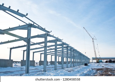 The structure of the building. Steel construction on the background of the winter landscape.