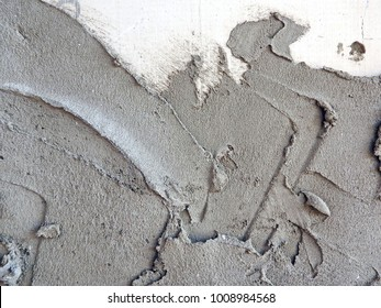 Structure of freshly laid uneven cement plaster. Building process.