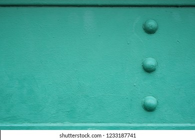 Structure of green metal beams with rivets, Steel girder bridge structure, Texture background
