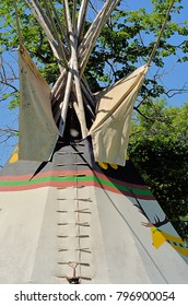 Structure of lodging of North American First Peoples (Native Americans/American Indians) from Plains and Inter-mountain regions. Painted large teepee.