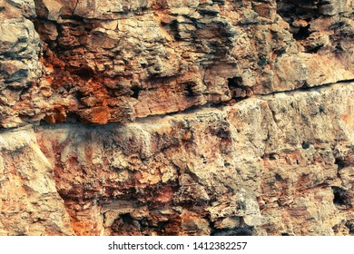 structure natural stone, vertical wall of rock limestone cliff under erosion, abstract nature background, location rocky  coast of Bulgaria, Europe
