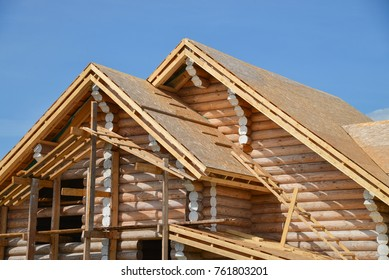 Structure of a new wooden house under construction on blue sky background