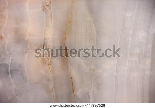 The structure of the semiprecious stone onyx background, pattern, texture