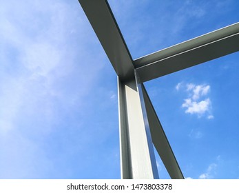 Structure of steel building construction with blue sky background.