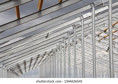 Structure of steel for building construction on sky background at the construction site