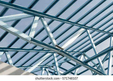 structure of steel roof frame for building construction on sky background - Metal Roof Trusses