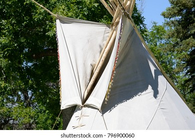 Structures of traditional lodging of North American First Peoples (Native Americans/American Indians) from Plains regions. Decorated smoke flaps