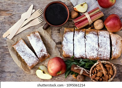 Strudel with apples and strawberries. Pie with apples or Classic apple strudel, summer pie. Summer breakfast in nature.
