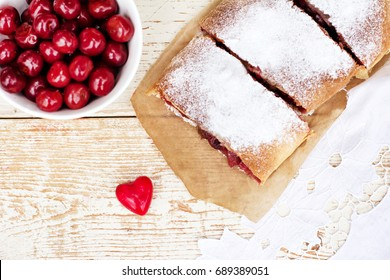 Strudel with a cherry. Cherry pie. Food on the nature. Summer cake. Pie, strudel with berries.