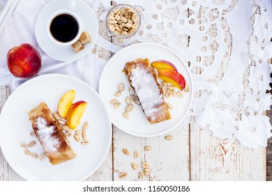 strudel with peaches, apples and peanuts