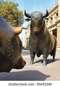 The struggle between bulls and bears symbolizing rising or falling financial markets.