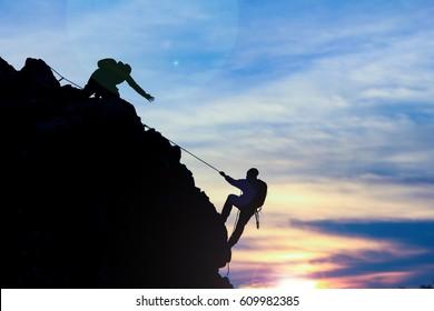 struggle of the rope climb on the rocks