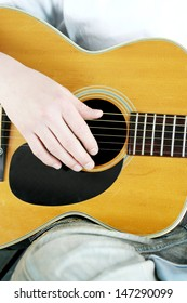 Strum the acoustic guitar