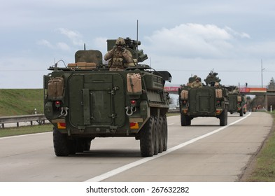 Strykers,wheeled armored vehicles drive on highway .The U.S. military convoy, returning from the Baltic countries to a German base, entered the territory of the Czech Republic