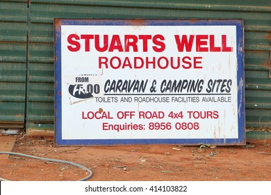 STUARTS WELL / ALICE SPRINGS, AUSTRALIA - December 5. Signboard of Stuarts Well Roadhouse and camping on road trip in the Australian Outback on December 5, 2015 in Stuarts Well / Alice Springs.