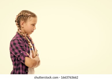 Stubborn concept. Stubborn child. Disagreement and stubbornness. Girl serious face offended. Kid looks strictly. Girl folded arms on chest looks serious copy space white background. Stubborn temper.