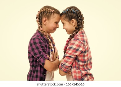Stubborn concept. Stubborn kids. Disagreement and stubbornness. Girls offended friends. Kids sisters looks strictly. Stubborn temper. Girls folded arms on chest looks serious white background.